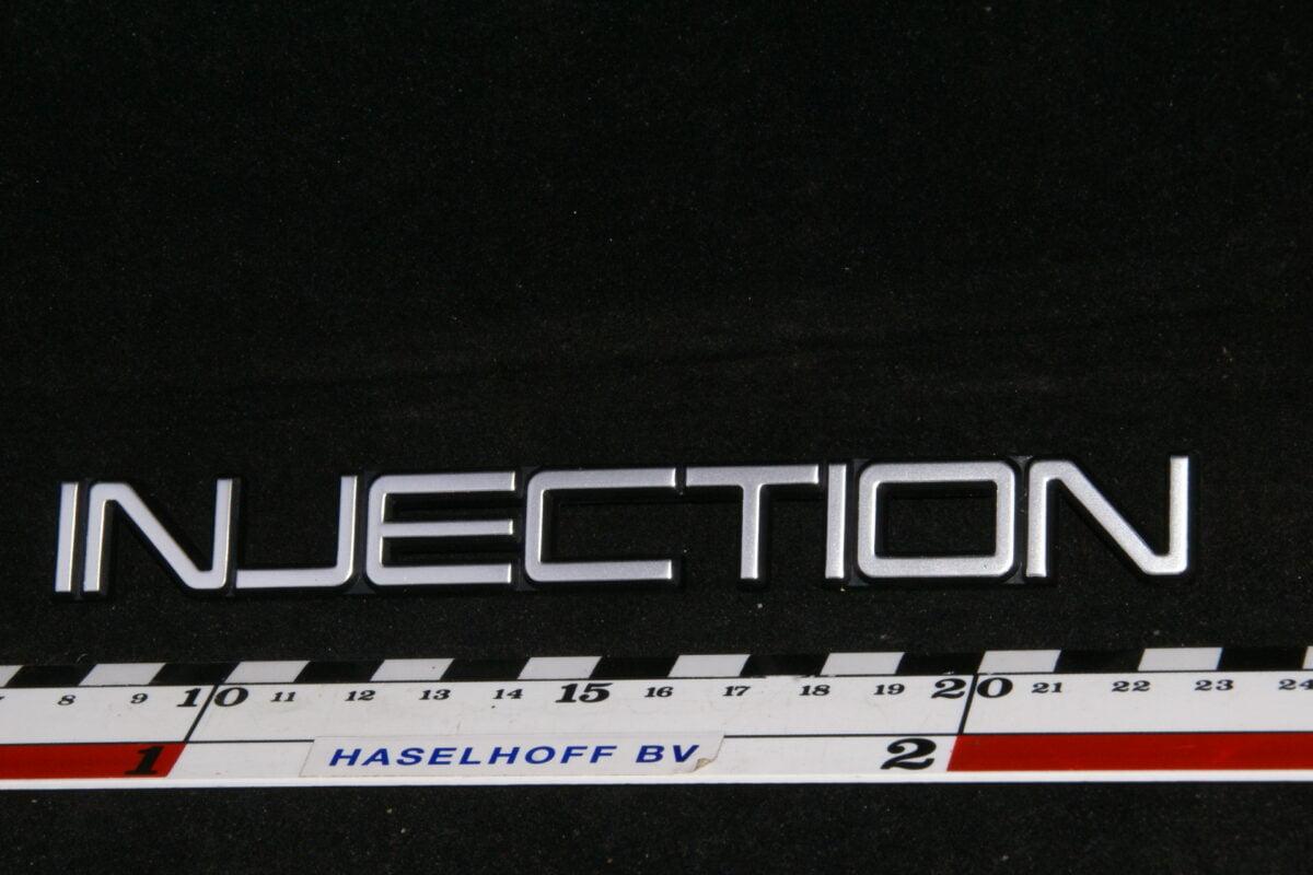 embleem kofferdeksel INJECTION 141100-0648-0